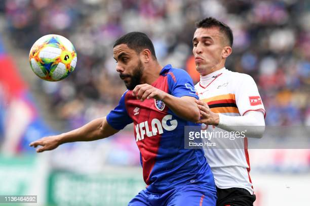 Diego Oliveira of FC Tokyo and Joao Schmidt of Nagoya Grampus compete for the ball during the J.League J1 match between FC Tokyo and Nagoya Grampus...