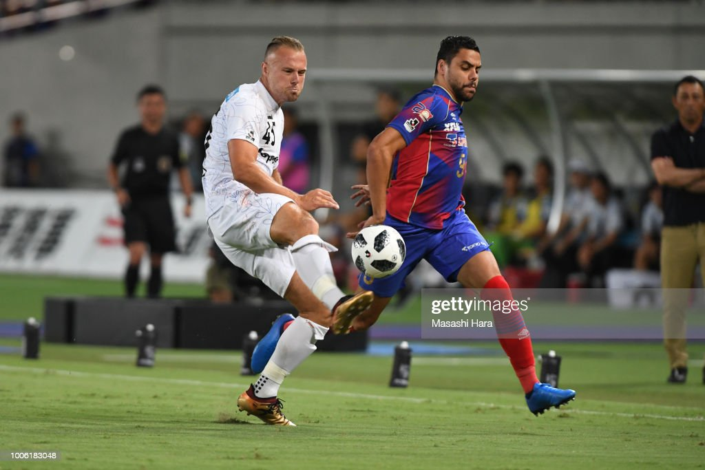 Diego Oliveira of FC Tokyo and Jordy Buijs of V-Varen Nagasaki compete for the ball during the J.League J1 match between FC Tokyo and V-Varen Nagasaki at Ajinomoto Stadium on July 27, 2018 in Chofu, Tokyo, Japan.