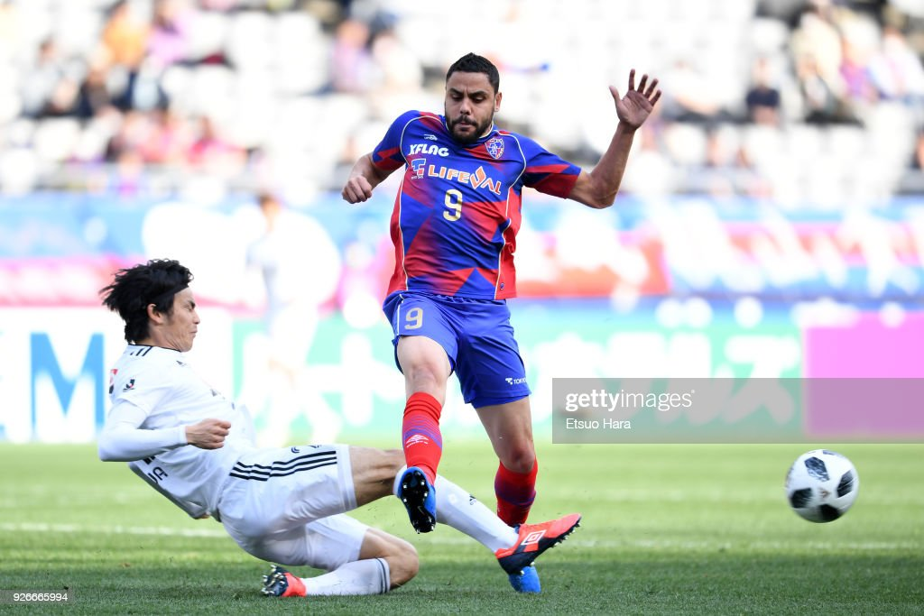Diego Oliveira (R) of FC Tokyo and Kazuki Oiwa of Vegalta Sendai compete for the ball during the J.League J1 match between FC Tokyo and Vegalta Sendai at Ajinomoto Stadium on March 3, 2018 in Chofu, Tokyo, Japan.