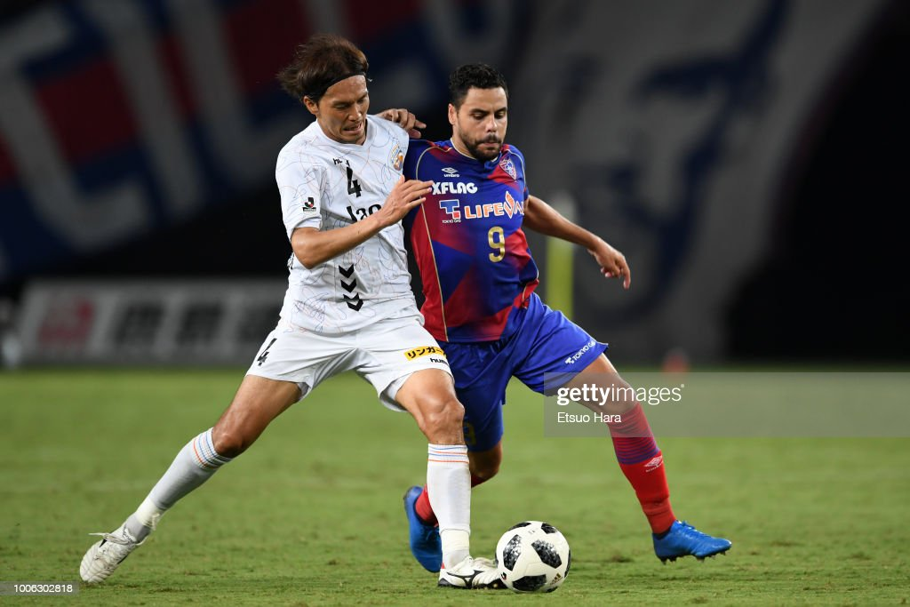 Diego Oliveira of FC Tokyo and Ryota Takasugi of V-Varen Nagasaki compete for the ball during the J.League J1 match between FC Tokyo and V-Varen Nagasaki at Ajinomoto Stadium on July 27, 2018 in Chofu, Tokyo, Japan.