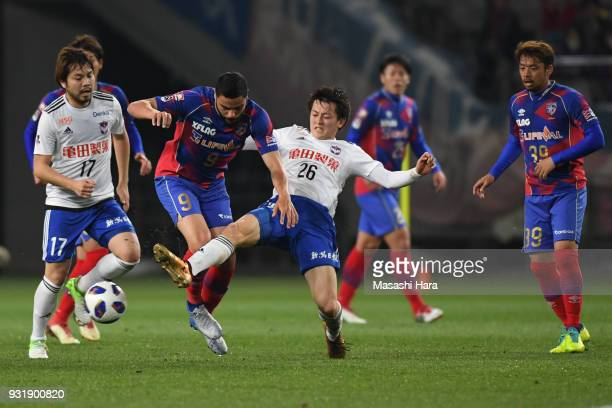 Diego Oliveira of FC Tokyo and Sachiro Toshima of Albirex Niigata compete for the ball during the JLeague YBC Levain Cup Group A match between FC...