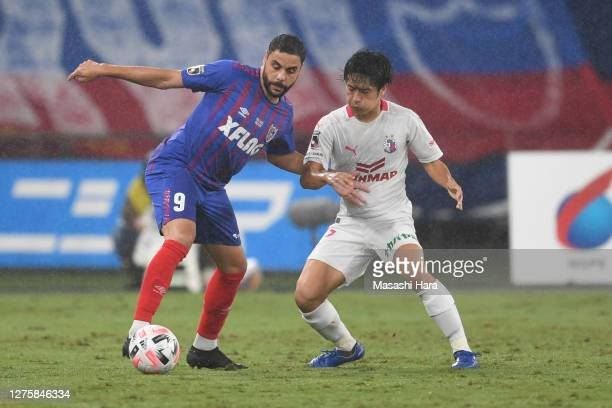 Diego Oliveira of FC Tokyo and Tatsuhiro Sakamoto of Cerezo Osaka compete for the ball during the J.League Meiji Yasuda J1 match between FC Tokyo and...