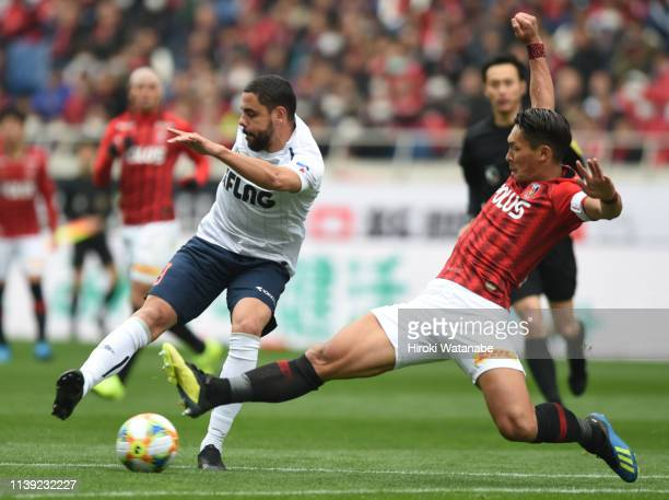 Diego Oliveira of FC Tokyo and Tomoaki Makino of Urawa Red Diamonds compete for the ball during the JLeague J1 match between Urawa Red Diamonds and...
