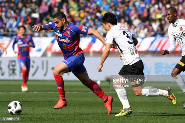 Diego Oliveira of FC Tokyo and Tomoya Ugajin of Urawa Red Diamonds compete for the ball during the JLeague J1 match between FC Tokyo and Urawa Red...