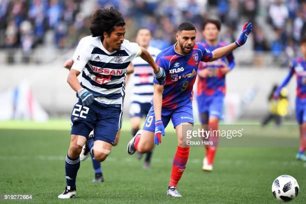 Diego Oliveira of FC Tokyo and Yuji Nakazawa of Yokohama FMarinos compete for the ball during the preseason friendly match between FC Tokyo and...