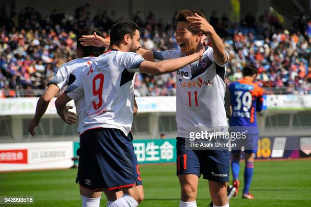 Diego Oliveira of FC Tokyo celebrates scoring his side's fourth goal with his team mate Kensuke Nagai during the JLeague J1 match between VVaren...