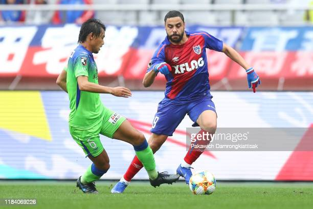 Diego Oliveira of FC Tokyo goes past Shonan Bellmare player during the J.League J1 match between FC Tokyo and Shonan Bellmare at Ajinomoto Stadium on...