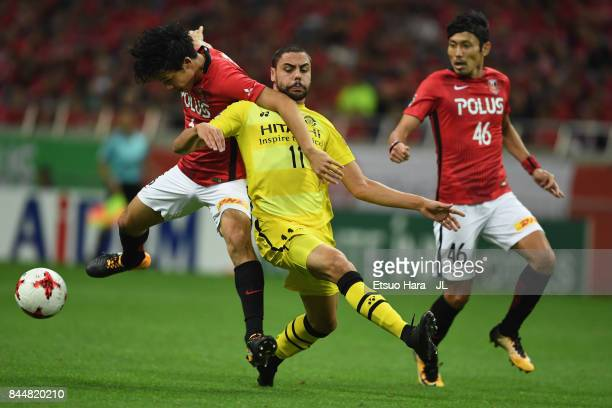 Diego Oliveira of Kashiwa Reysol and Wataru Endo of Urawa Red Diamonds compete for the ball during the JLeague J1 match between Urawa Red Diamonds...