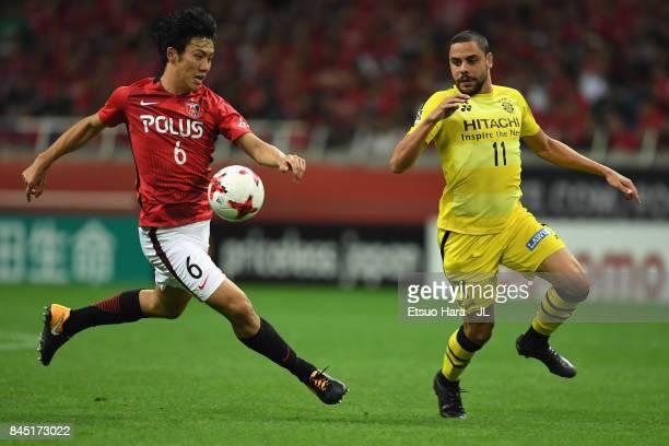 Diego Oliveira of Kashiwa Reysol and Wataru Endo of Urawa Red Diamonds compete for the ball during the JLeague J1 match between Urawa Red Diamonds...