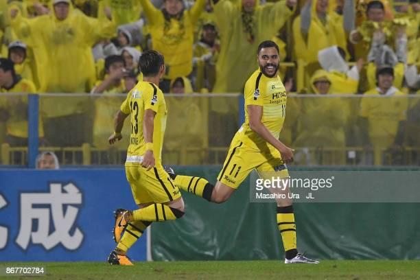 Diego Oliveira of Kashiwa Reysol celebrates scoring his side's second goal with his team mate Ryuta Koike during the JLeague J1 match between Kashiwa...