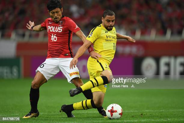 Diego Oliveira of Kashiwa Reysol controls the ball under pressure of Ryota Moriwaki of Urawa Red Diamonds during during the JLeague J1 match between...