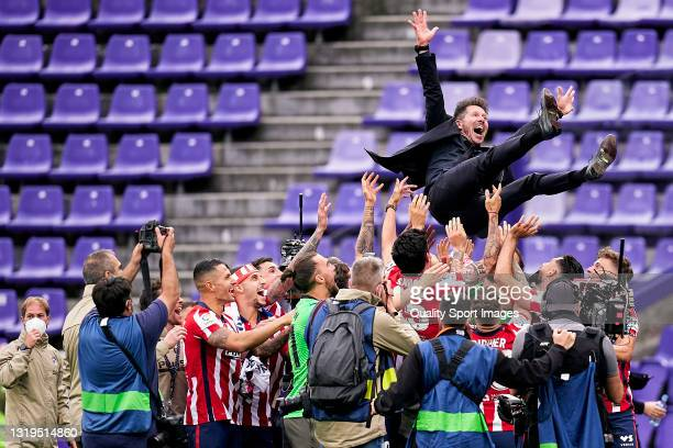 Diego Pablo Simeone, head coach of Atletico de Madrid is thrown by the air after winning LaLiga title at the end of the La Liga Santander match...