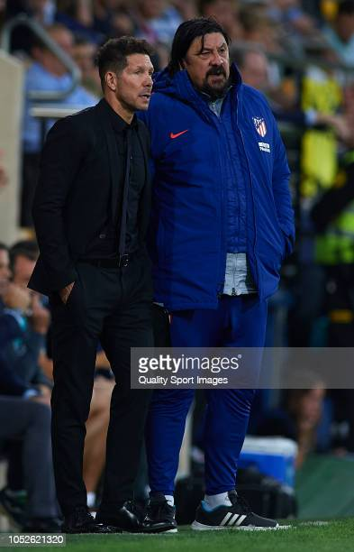Diego Pablo Simeone Manager of Atletico de Madrid consults his assistant German Burgos during the La Liga match between Villarreal CF and Club...