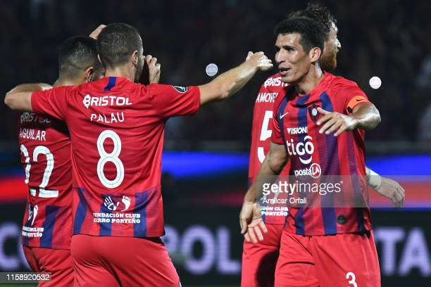 Diego Palau and Marcos Caceres of Cerro celebrate after winning a round of sixteen second leg match between Cerro Porteño and San Lorenzo at General...