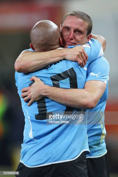 Diego Perez and Egidio Arevalo of Uruguay celebrate after winning a penalty shoot out during the 2010 FIFA World Cup South Africa Quarter Final match...