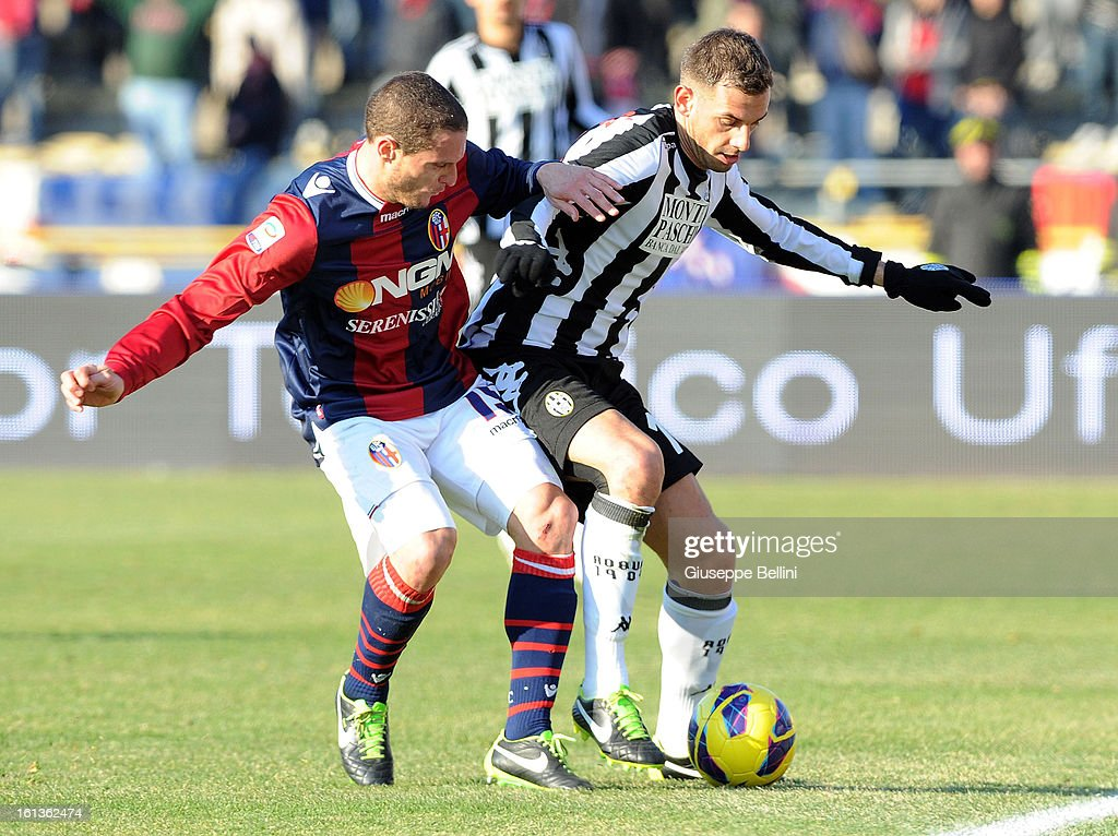 Diego Perez of Bologna (L) and Francesco Della Rocca of Siena in action during the Serie A match between Bologna FC and AC Siena at Stadio Renato Dall'Ara on February 10, 2013 in Bologna, Italy.