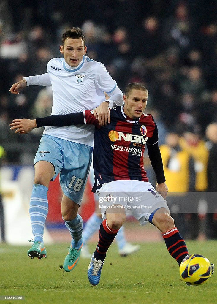 Diego Perez (R) of Bologna FC competes for the ball with Libor Kozak of SS Lazio during the Serie A match between Bologna FC and S.S. Lazio at Stadio Renato Dall'Ara on December 10, 2012 in Bologna, Italy.