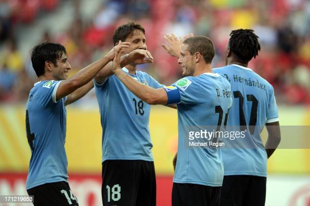 Diego Perez of Uruguay celebrates withe Gaston Ramirez Nicolas Lodeiro and Abel Hernandez after scoring a goal in the 27th minute against Tahiti...