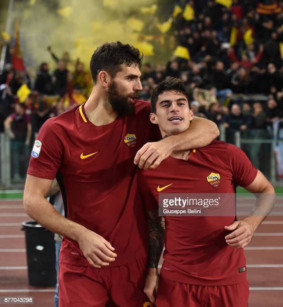 Diego Perotti of AS Roma celebrates with Federico Fazio after scoring the opening goal during the Serie A match between AS Roma and SS Lazio at...