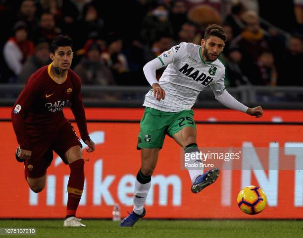 Diego Perotti of AS Roma competes for the ball with Domenico Berardi of US Sassuolo during the Serie A match between AS Roma and US Sassuolo at...