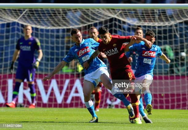 Diego Perotti of AS Roma competes for the ball with Fabian Ruiz and Dries Mertens of SSC Napoli during the Serie A match between AS Roma and SSC...
