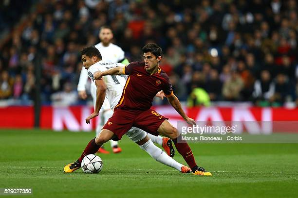 Diego Perotti of AS Roma duels for the ball with Casemiro of Real Madrid during the UEFA Champions League round of 16 2nd leg football match between...