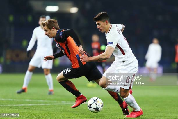 Diego Perotti of AS Roma gets away from Bohdan Butko of Shakhtar Donetsk during the UEFA Champions League Round of 16 First Leg match between...