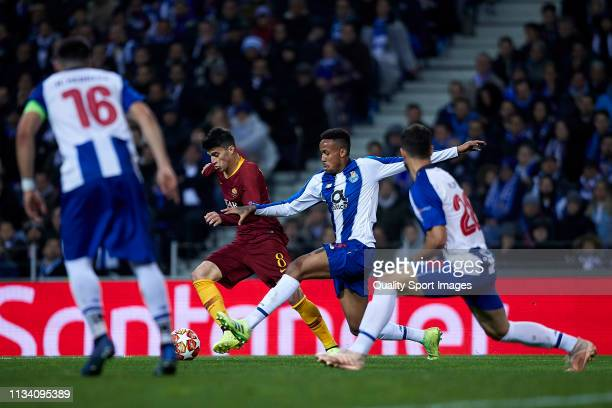 Diego Perotti of AS Roma is fouled by Eder Militao of FC Porto and a penalty is later awarded to AS Roma during the UEFA Champions League Round of 16...