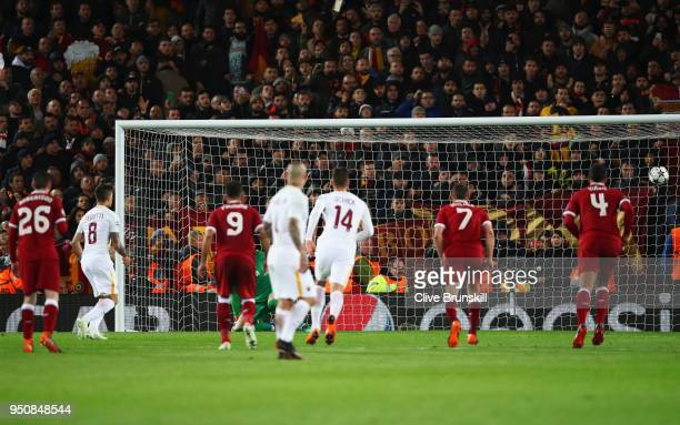 Diego Perotti of AS Roma scores his sides second goal from the penalty spot during the UEFA Champions League Semi Final First Leg match between...