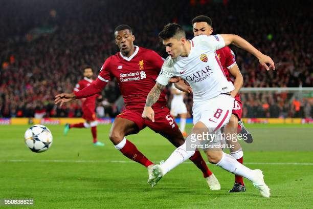 Diego Perotti of AS Roma takes a shot during the UEFA Champions League Semi Final First Leg match between Liverpool and AS Roma at Anfield on April...