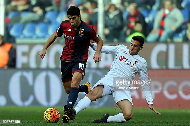 Diego Perotti of Genoa CFC battles for the ball with Matias Vecino of ACF Fiorentina during the Serie A match between Genoa CFC and ACF Fiorentina at...