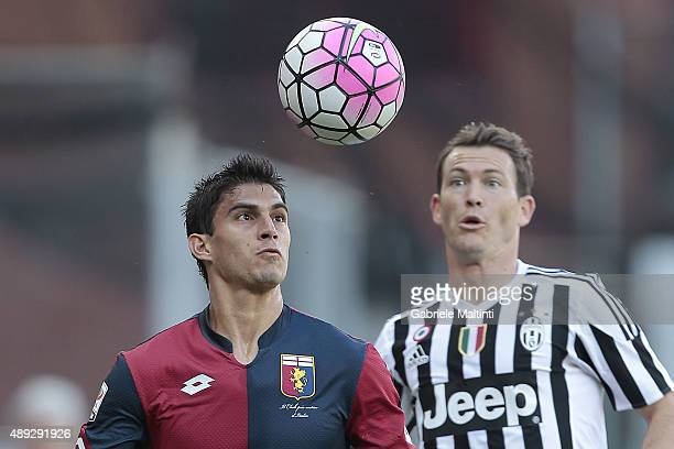 Diego Perotti of Genoa CFC battles for the ball with Stepahan Lichtsteiner of Juventus FC during the Serie A match between Genoa CFC and Juventus FC...