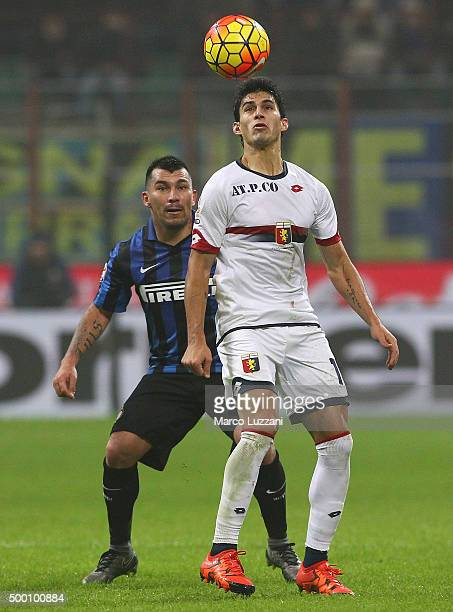 Diego Perotti of Genoa CFC is challenged by Gary Alexis Medel of FC Internazionale Milano during the Serie A match between FC Internazionale Milano...