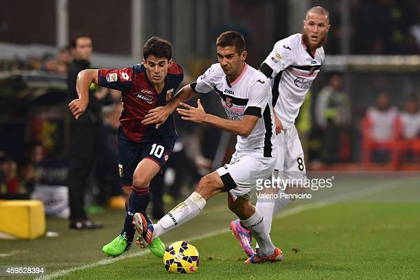 Diego Perotti of Genoa CFC is challenged by Ivaylo Chochev of US Citta di Palermo during the Serie A match between Genoa CFC and US Citta di Palermo...