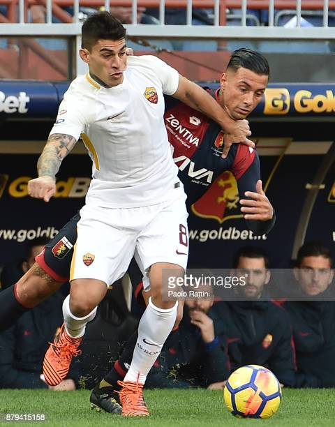 Diego Perotti of Roma and Armando Izzo of Genoa vie for the ball during the Serie A match between Genoa CFC and AS Roma at Stadio Luigi Ferraris on...