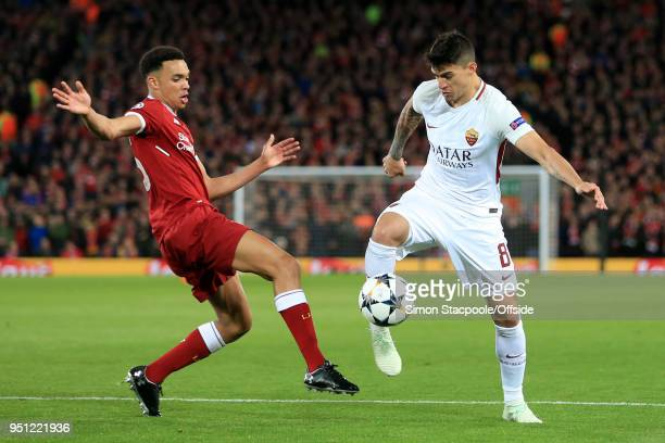 Diego Perotti of Roma battles with Trent AlexanderArnold of Liverpool during the UEFA Champions League Semi Final First Leg match between Liverpool...