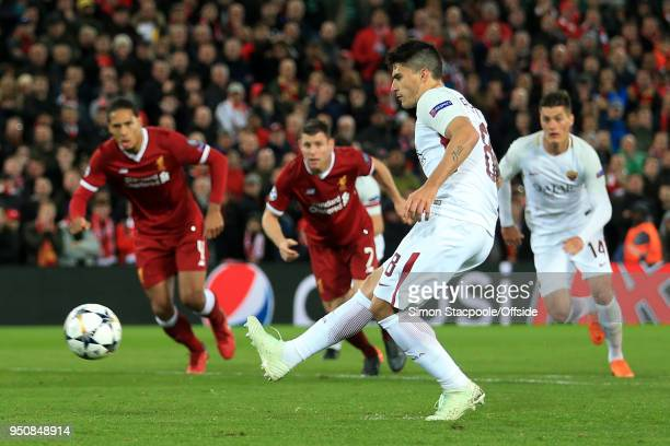 Diego Perotti of Roma scores their 2nd goal with a penalty during the UEFA Champions League Semi Final First Leg match between Liverpool and AS Roma...