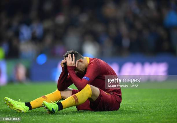 Diego Perotti of Roma sits dejected on the pitch after the UEFA Champions League Round of 16 Second Leg match between FC Porto and AS Roma at Estadio...