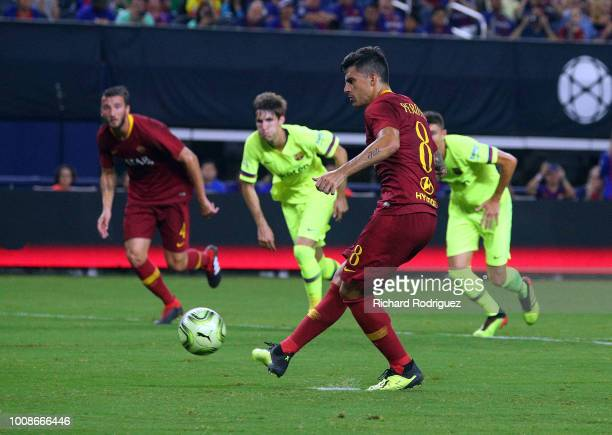 Diego Perotti of Roma takes a penalty for a goal in the second half of a soccer match against Barcelona at ATT Stadium on July 31 2018 in Arlington...