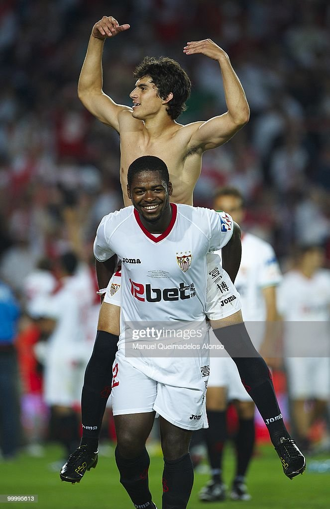 Diego Perotti of Sevilla celebrates with his teammate Romaric after the Copa del Rey final between Atletico de Madrid and Sevilla at Camp Nou stadium on May 19, 2010 in Barcelona, Spain. Sevilla won 2-0.