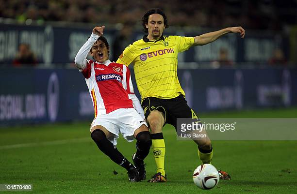 Diego Perotti of Sevilla is challenged by Neven Subotic of Dortmund during the UEFA Europa League group J match between Borussia Dortmund and Sevilla...