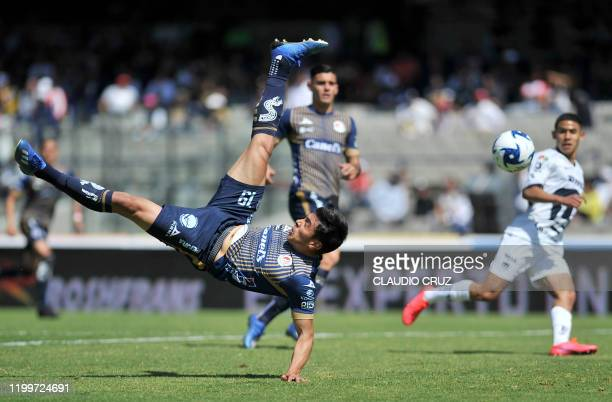Diego Pineda of San Luis kicks the ball against Pumas during their Mexican Clausura tournament football match at the Mexico 68 stadium in Mexico City...