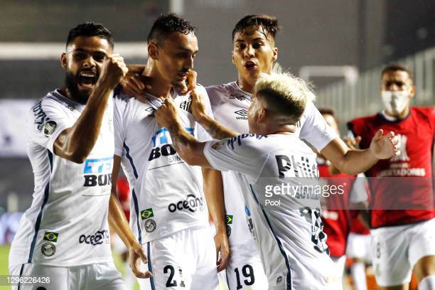 Diego Pituca of Santos celebrates with teammates after scoring the first goal of his team during a semifinal second leg match between Santos and Boca...