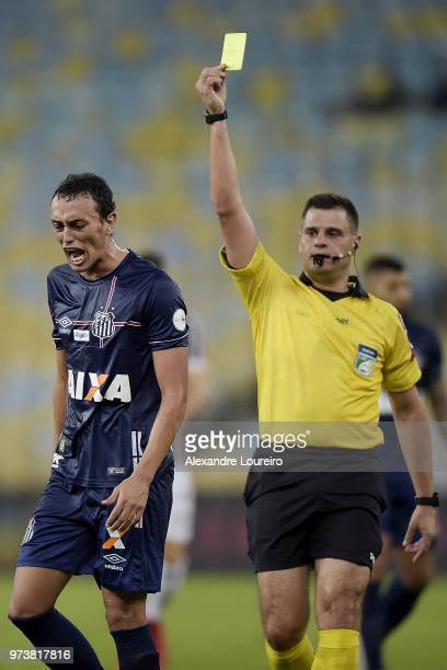 Diego Pituca of Santos recevies a yellow card from referee Rafael Traci during the match between Fluminense and Santos as part of Brasileirao Series...