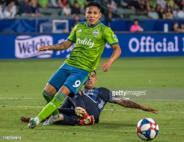 Diego Polenta of Los Angeles Galaxy defends against Raul Ruidiaz of Seattle Sounders during the Los Angeles Galaxy's MLS match against Seattle...