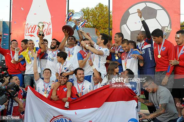 Diego Polenta of Nacional lifts the trophy to celebrate after winning a match between Nacional and Boston River as part of Campeonato Uruguayo 2016...