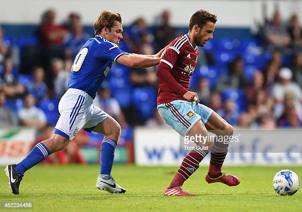 Diego Poyet of West Ham United and Jay Tabb of Ipswich Town in action during the preseason friendly match between Ipswich Town and West Ham United at...