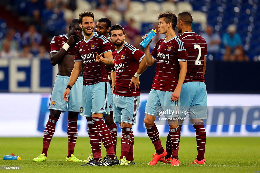 Diego Poyet, Sebastian Lietget and Daniel Potts of West Ham United celebrate during the penalty shoot-out of the match between FC Schalke 04 and West Ham United as part of the Schalke 04 Cup Day at Veltins-Arena on August 2, 2014 in Gelsenkirchen, Germany. The match between Schalke and West Ham United ended 6-7 after penalty shoot-out.