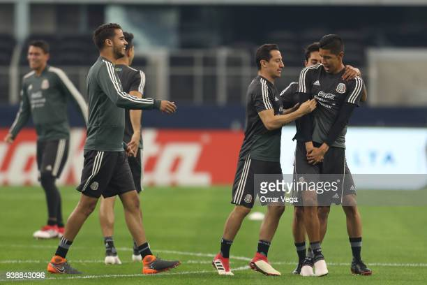 Diego Reyes and Andres Guardado of Mexico joke during the Mexico training session ahead of the FIFA friendly match against Croatia at ATT Stadium on...