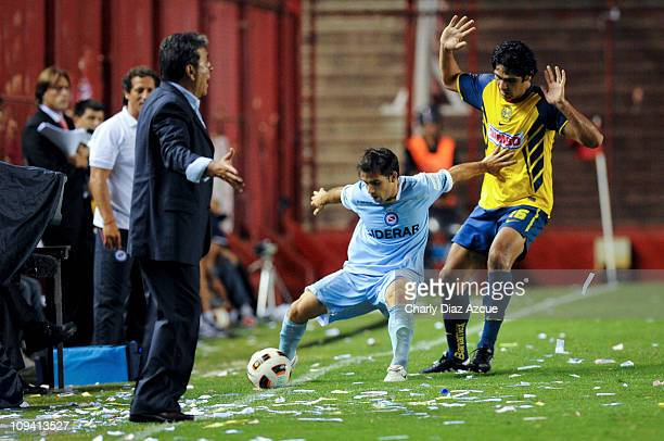 Diego Reyes of America struggles for the ball while his coach Carlos Reinoso protest during a match as part of the Santander Libertadores Cup 2011 at...